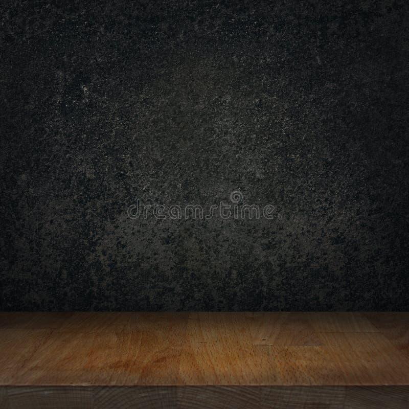 Leere hölzerne Spitzentabelle und schwarzer Steingraphitküchenhintergrund lizenzfreie abbildung
