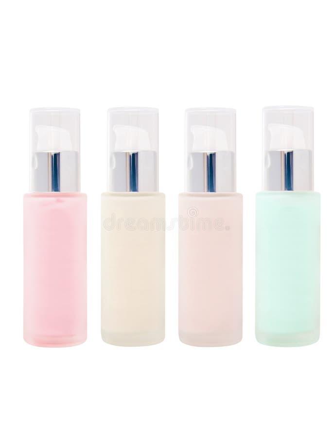 Leere kosmetische Glasflaschen mit Pumpe lizenzfreies stockbild