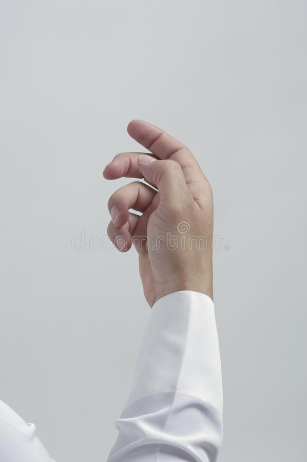 Leere männliche Hand für die Platzierung des Handys oder anderen Gegenstand-Isolats stockfotos