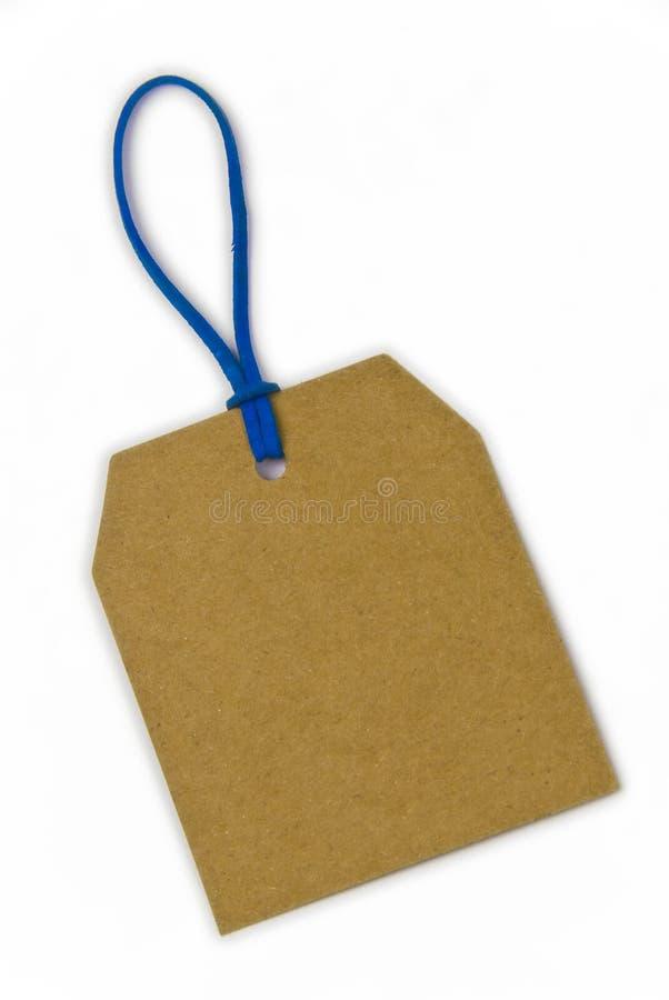 Leere Papiermarke gebunden mit blauer Zeichenkette stockfoto