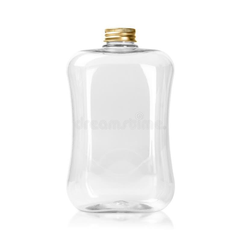 Leere Plastikflasche mit der Goldkappe lokalisiert auf weißem Hintergrund Klares Glas- oder Maurerpaket ?ber Wei? lizenzfreie stockbilder