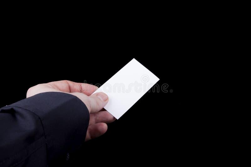 Leere Visitenkarte in der Hand. stockbilder