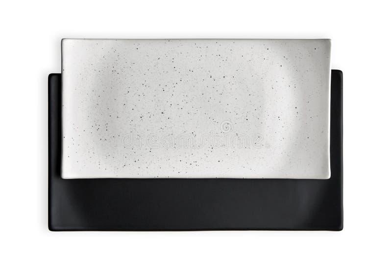 Leeren Sie die rechteckigen Platten-, weiße und Schwarzekeramikplatten, Ansicht von oben lokalisiert auf weißem Hintergrund mit B stockbilder