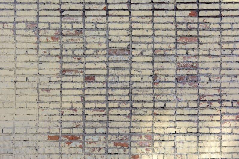 Leerer Hintergrund gemacht von den Ziegelsteinen gemalt im Gelb Alte Backsteinmauer, mit Flecken Beschaffenheit der Maurerarbeit lizenzfreies stockbild