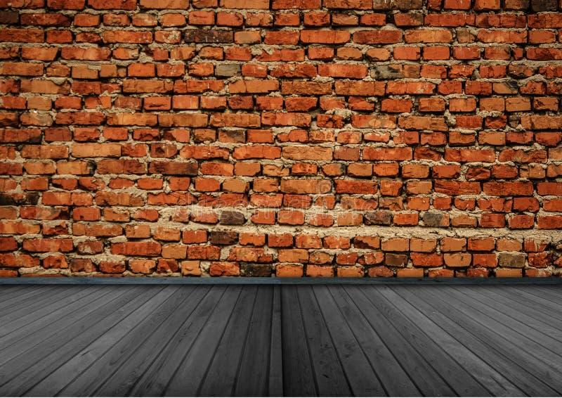 Leerer Raum mit Wand und Bretterboden des roten Backsteins lizenzfreies stockbild