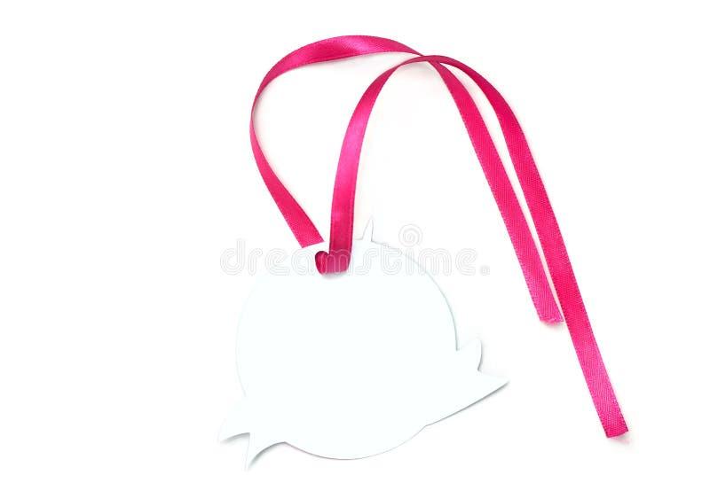 Leerer weißer Aufkleber und rosa Band stockfotografie