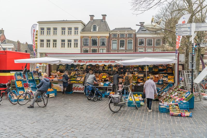 People buying vegetable`s at the saturday market. Leeuwarden, The Netherlands, april 14 2018, People buying vegetable`s at the saturday market royalty free stock image