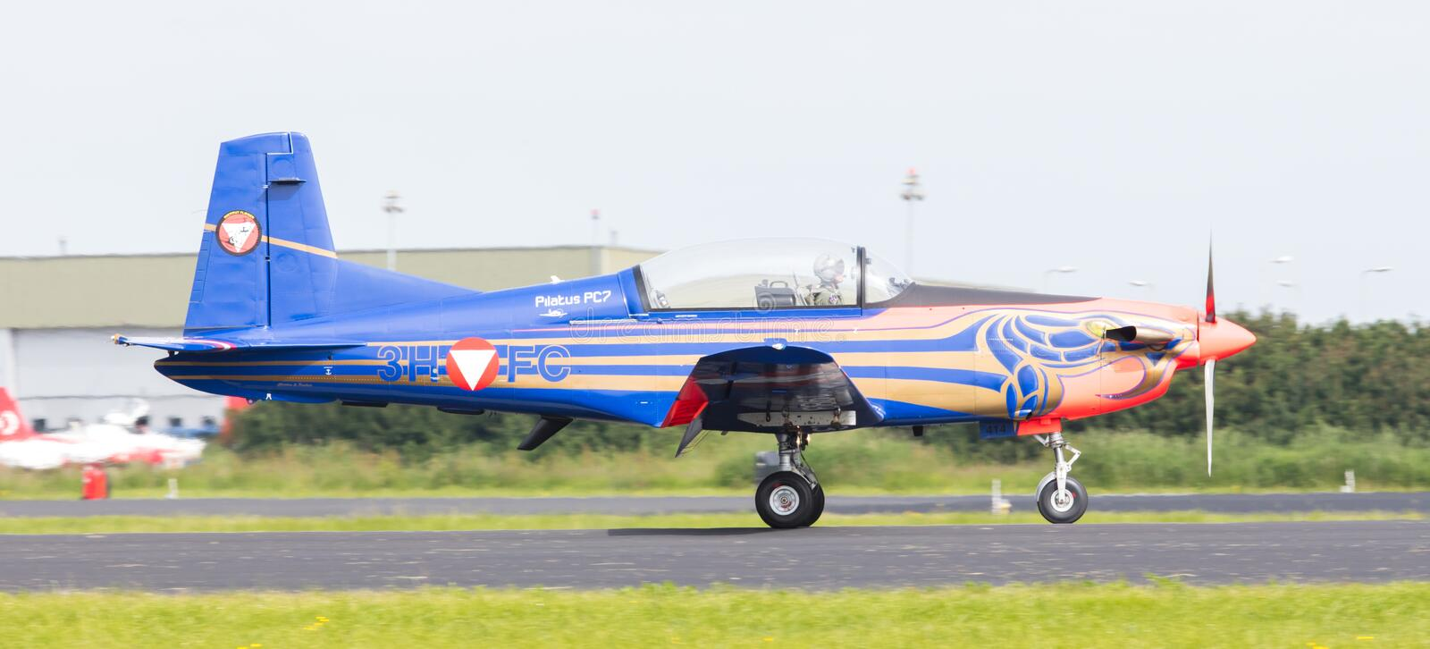 LEEUWARDEN, THE NETHERLANDS - JUNE 10, 2016: Austian PC-7 Pilatus during a demonstration at the Royal Netherlands Air Force Days. On june 10, Leeuwarden, The stock photography
