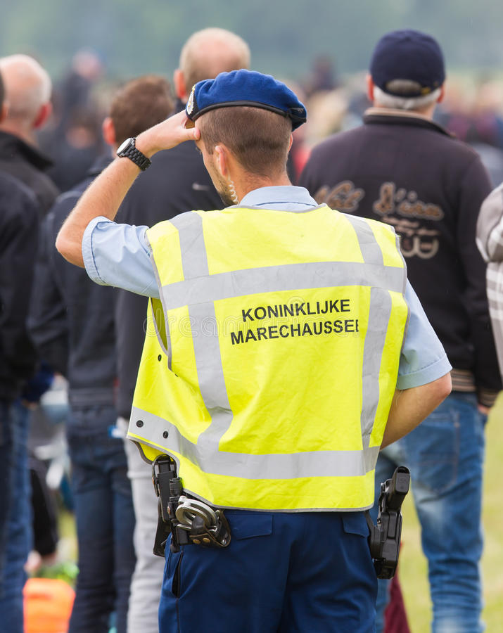 LEEUWARDEN, THE NETHERLANDS - JUNE 11, 2016; Koninklijke Marechaussee (Military police) patrolling at the Airshow on June royalty free stock photo