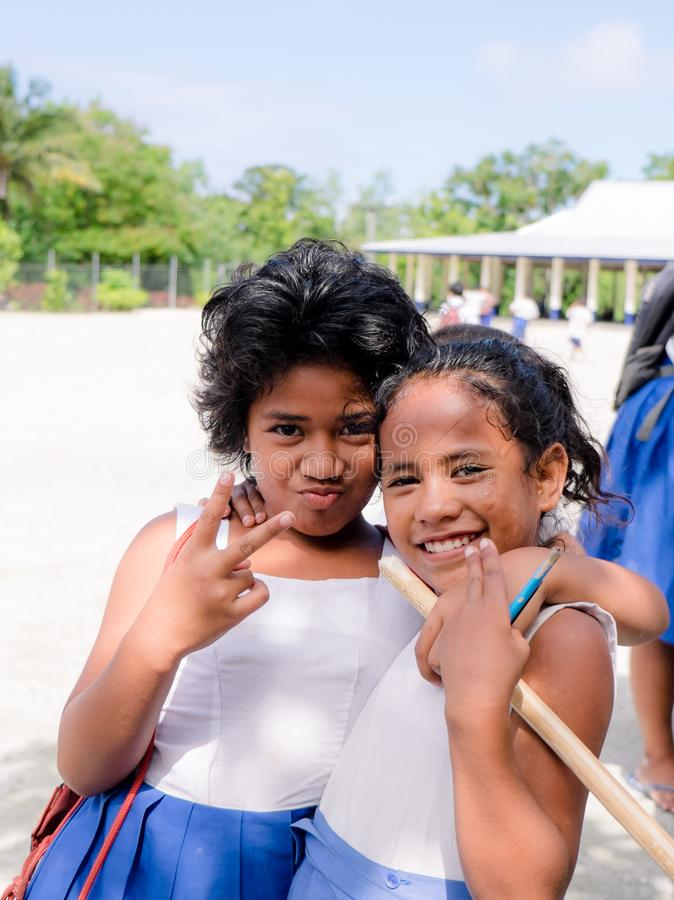 Lefaga, Upolu, Samoa - August 2, 2018: Primary school girls with. Attitude stock photo