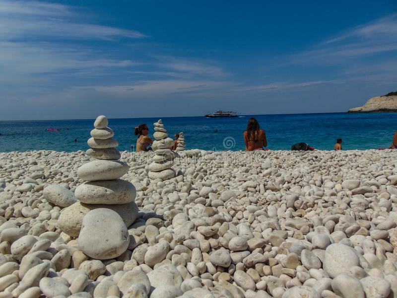 Stones balanced on beach. Lefkada, Greece - August 2018: Stones balanced on Porto Katsiki beach, meditation, concept, csr, tower, stack, summer, stability stock photography