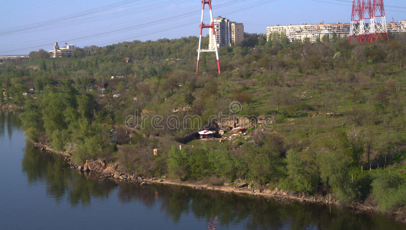 Left bank of Dnepr river. Left bank of Dnepr river with Zaporozhye city electrification and little house near the bank. Shot taken from Hortica island royalty free stock images