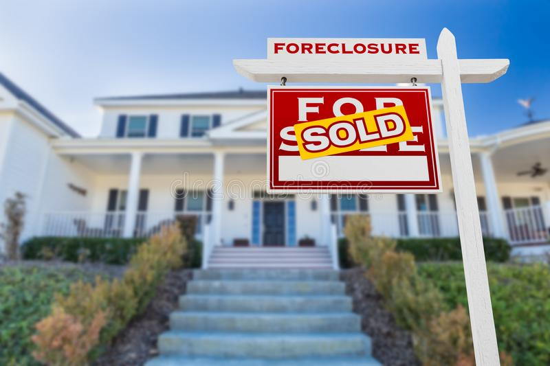 Left Facing Foreclosure Sold For Sale Real Estate Sign in Front of Home stock image