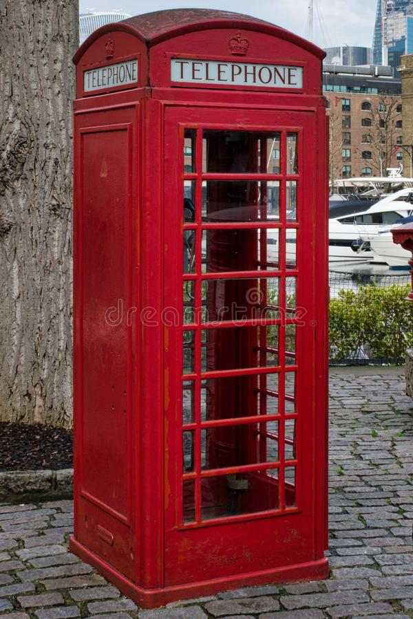 Traditional red english phone booth facing right. Left facing traditional red english phone box stock photography