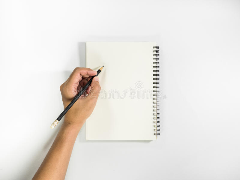 Left hand with pencil prepare to writting on notebook. stock photography