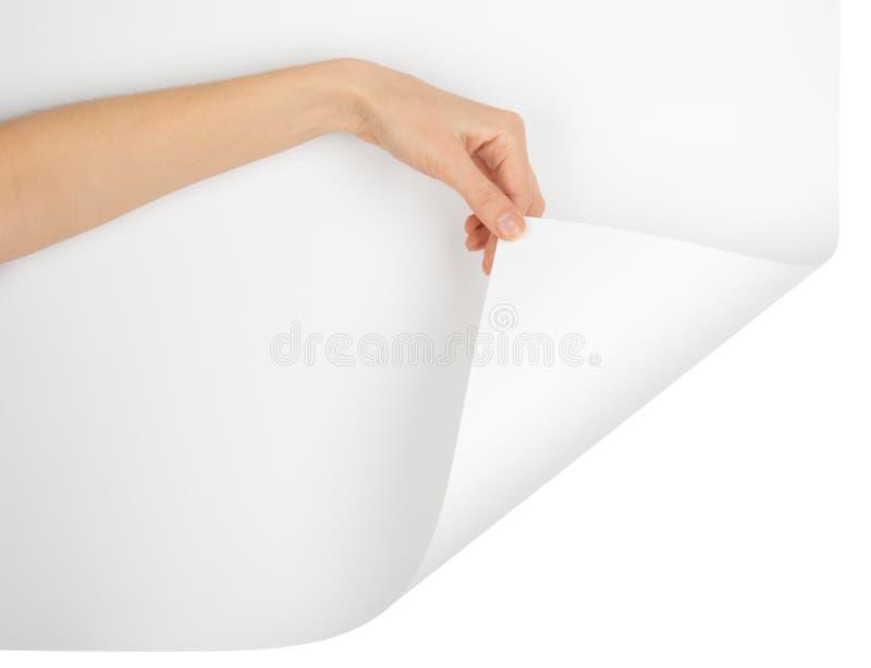 Left hand turning empty page corner stock image