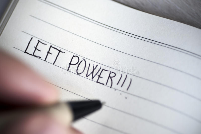 Left-handed man handwriting the text left power stock images