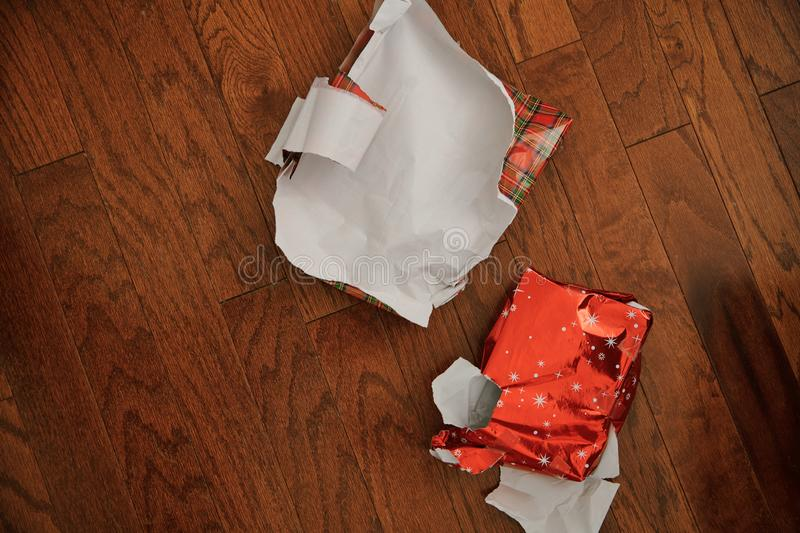 Left over Christmas gift wrapping paper royalty free stock images