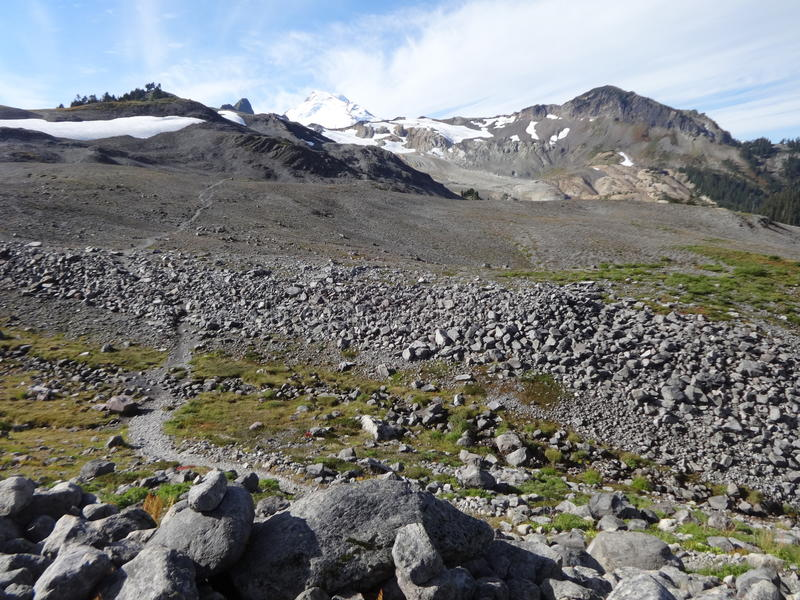 Left over snow on the ridge of Mount Baker from Ptarmigan Ridge trail. Moonscape looks like the Ptarmigan Ridge trail in Mount Baker, Washington stock image