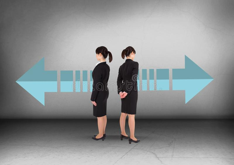 Left or right arrows with Businesswoman looking in opposite directions royalty free stock photo