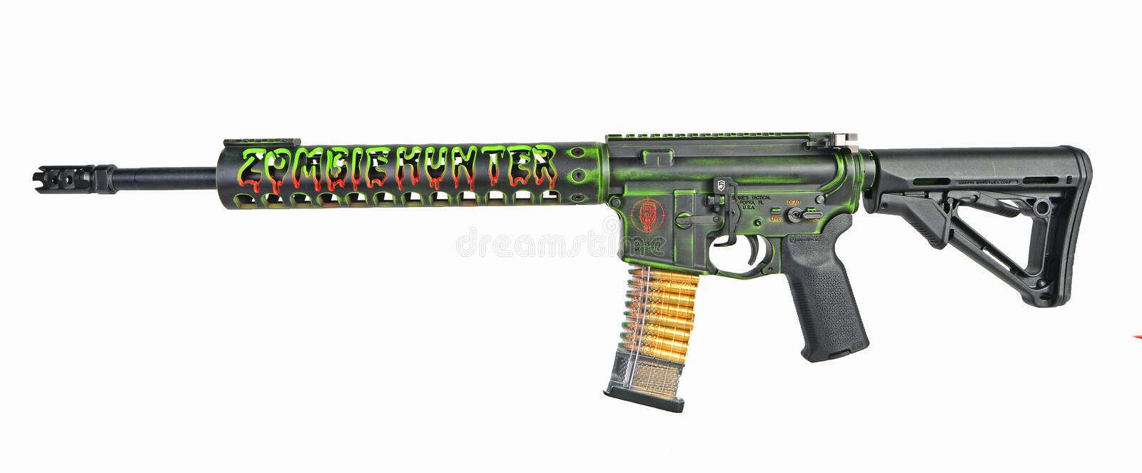 Left side of isolated Custom AR15 rifle Zombie Hunter loaded and ready stock images