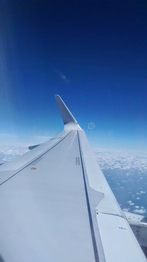 Left wing of a plane royalty free stock photo