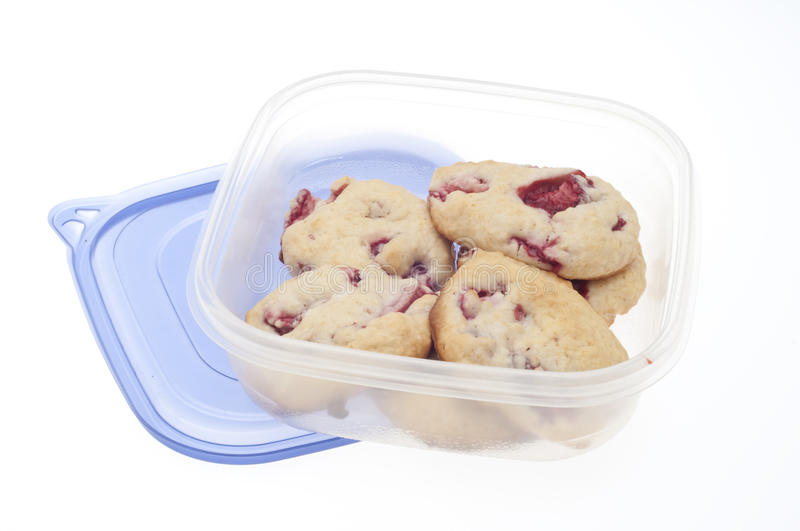 Leftover Strawberry Shortcake Cookies. In Plastic Container Isolated on White royalty free stock image