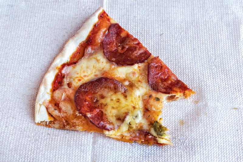 Leftovers of pizza on a napkin. stock photography