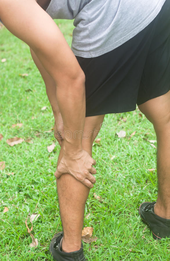 Leg calf sport muscle injury. Runner with muscle pain. Leg calf sport muscle injury. Runner with muscle pain in leg royalty free stock photo