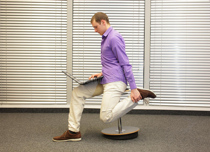 Leg exercise during office work royalty free stock images
