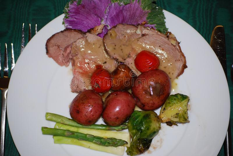 Leg of Lamb with red potatoes stock image