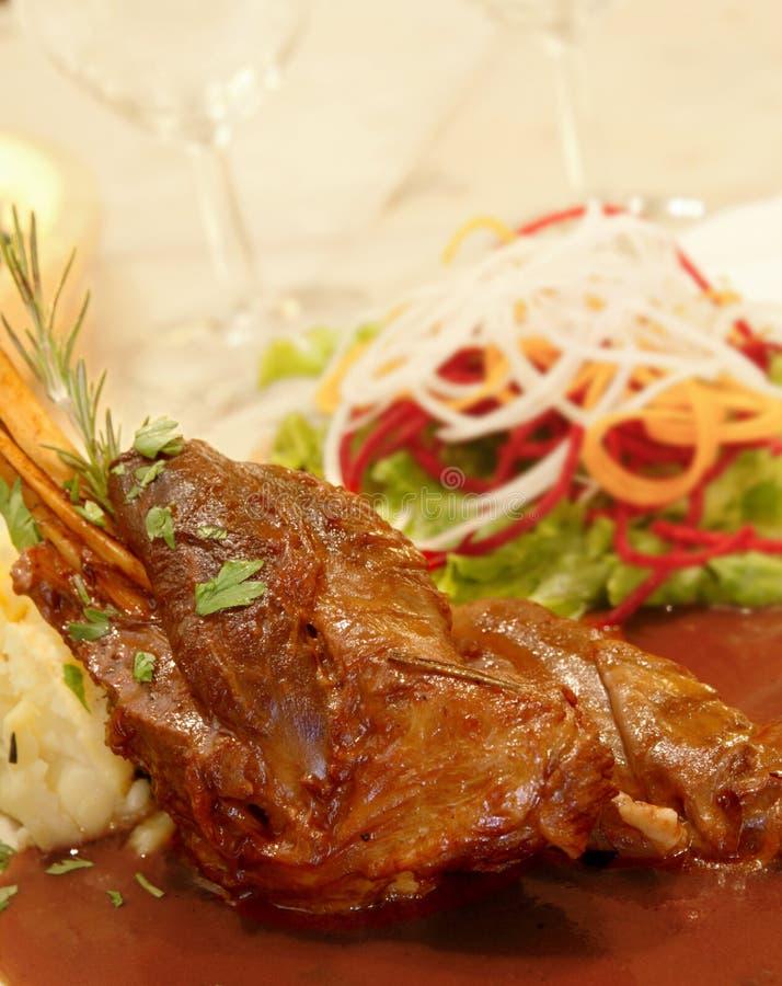 Leg of lamb roast. Dish set stock image