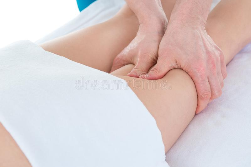 Leg massage. Therapist doing massage of legs at clinic, applying royalty free stock photo
