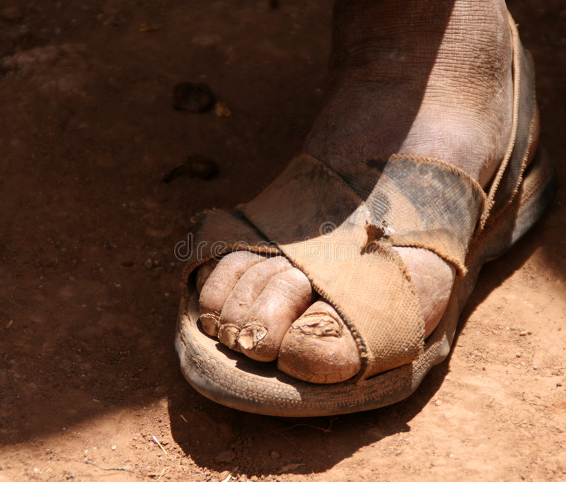 Leg with sandals. Sandalled feet of a farmer in the andes of south america, peru royalty free stock photography