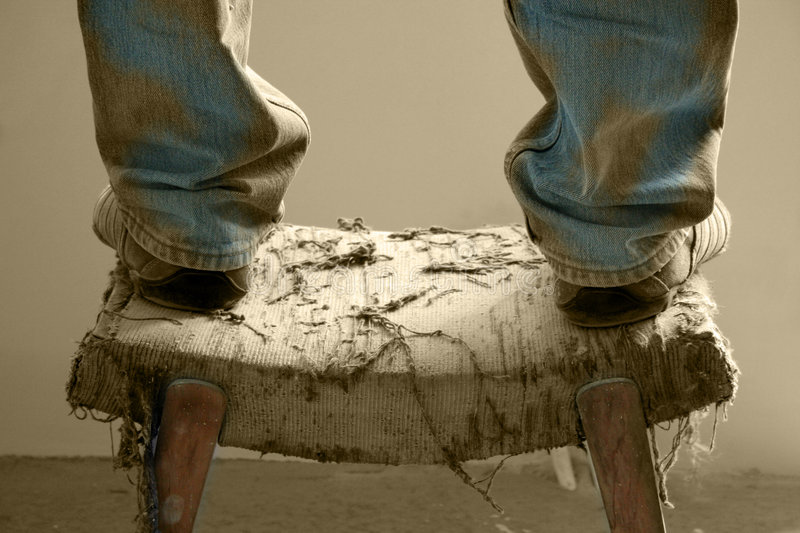 The leg of a small chair. Legs, jeans, boots of people of a small chair Bulgaria-picsvet.com royalty free stock photos