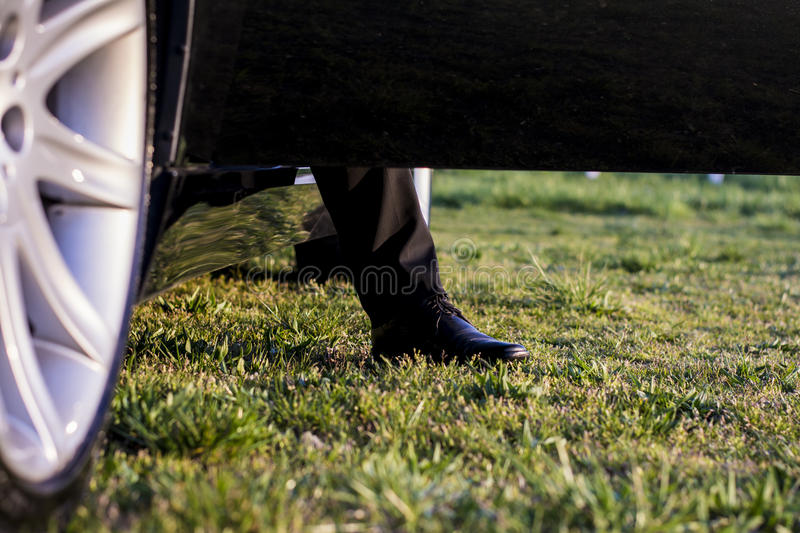 Download Leg steping out from a car stock photo. Image of suit - 39500222