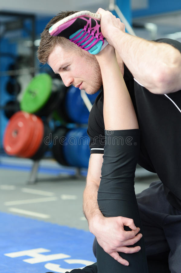 Leg stretching with personal trainer royalty free stock image