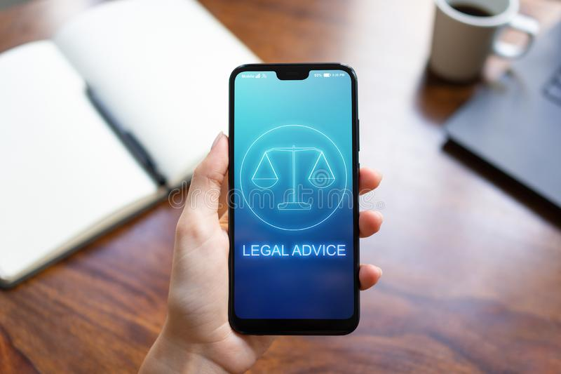 Legal advice icons on mobile phone screen. Attorney at law, consultation, supprot. Business concept. stock photo