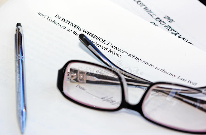 Legal Clause. Signing a last will and testament. An image of the last clause of the testament, a pair of glasses and a pen royalty free stock photography