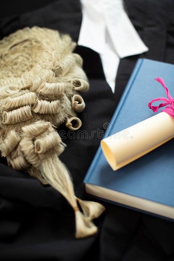 Legal Concept Still Life Of Barristers Wig With Gown And Brief. Legal Still Life Of Barristers Wig With Gown And Brief royalty free stock photography