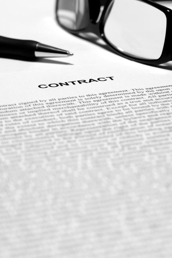 Legal Contract in English with Ink Pen and Glasses royalty free stock images
