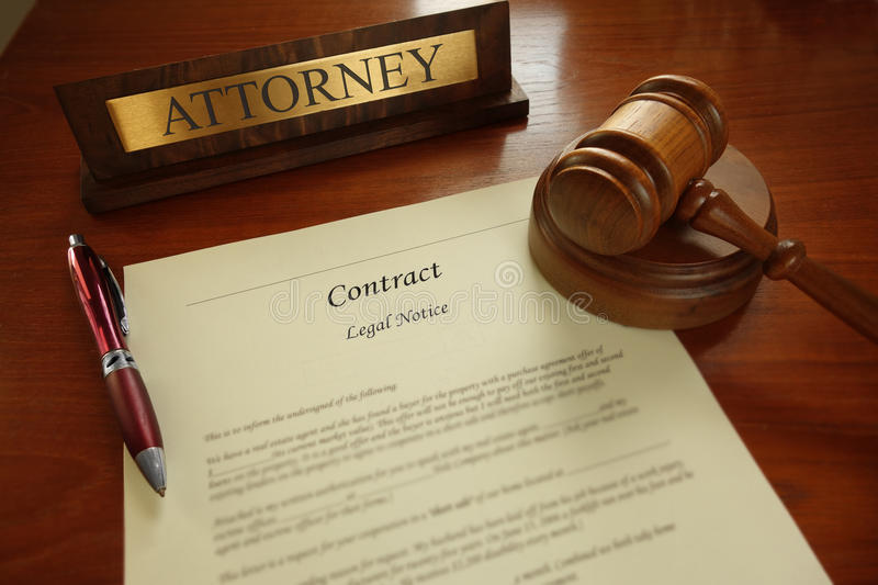 Legal contract. With gavel and Attorney name plate on a desk royalty free stock images