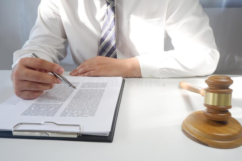 Legal counsel presents a contract with gavel and legal law. Justice and lawyer concept stock photos