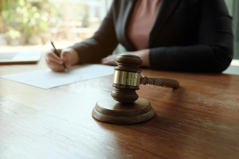 Legal counsel presents to the client a signed contract with gavel and legal law. Justice and lawyer  law of advisor Concepts royalty free stock photography