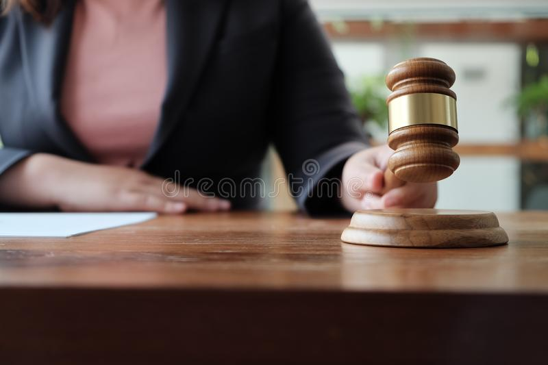 Legal counsel presents to the client a signed contract with gavel and legal law. Justice and lawyer  law of advisor Concepts royalty free stock image