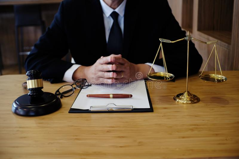 Legal counsel presents to the client a signed contract with gave stock images