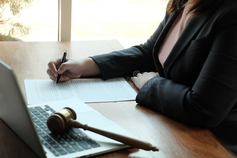 Legal counsel presents to the client a signed contract with gavel and legal law. Justice and lawyer  law of advisor Concepts royalty free stock images
