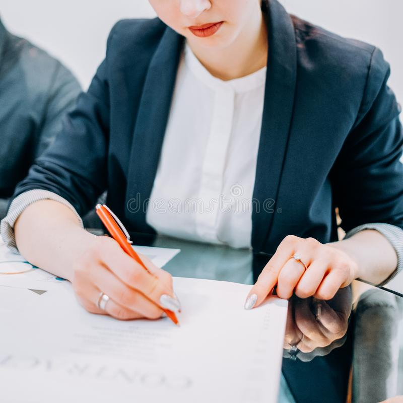 Legal deal successful business woman contract. Legal deal. Partnership and cooperation. Cropped shot of successful business woman signing contract royalty free stock photos