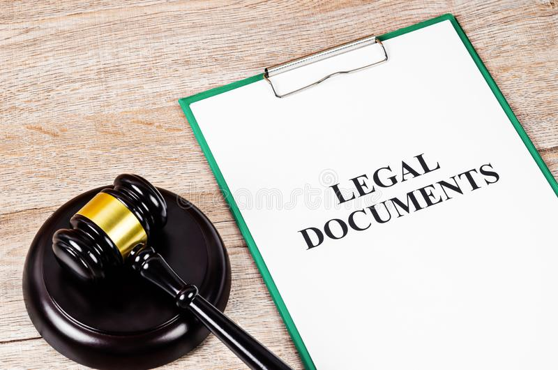 Legal document paper file with gavel stock images