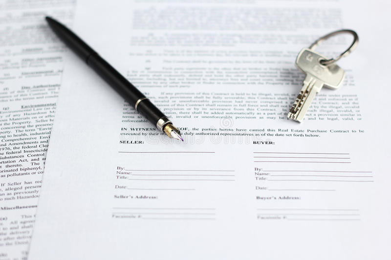 Legal document for sale of real estate, with fountain pen and house keys royalty free stock photos